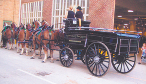 Photo by John Bunsold Larry and Carol Hitzfield and crew with their six-horse hitch from Roanoke, Indiana.