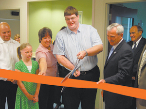 Distinguished guests cut the ribbon to officially open St. Joseph Hospital's new regional burn center and outpatient burn and wound clinic. Participating in the ribbon cutting ceremony are, left to right: Kevin McNabb, burn survivor; Brianna Bolinger, burn survivor; Deb Brandenberger, nurse practitioner, Indiana Wound Care; Jordan Long, burn survivor; Mayor Tom Henry; and Don Schenkel, chairman of the board, St. Joseph Hospital.