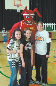 Maplewood students, Janessa Surine, Dena Short and PE teacher Krista Marcum pose with Mad Ants mascot in support of the Hoops for Hearts charity, Monday, February 23, 2009.