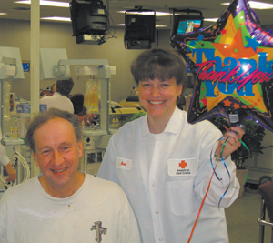 Platelet donor Benton Rhoades from Waynedale and American Red Cross staff Ann Drake.