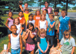 """Mt. Calvary Lutheran school-age summer program teachers Wendy Corcoran and Kayla Lambert pose with their group after collecting 18 lbs of trash on their """"trash walk""""."""