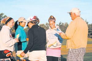 Olympia Olson (far left) listens to instructions during the Sectional Tournament held at Timber Ridge Golf Course in Bluffton.