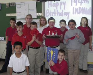 Indiana's birthday was celebrated by learning all about the state and its symbols. The students at St. Therese ended the day with a cake and singing. Their teacher is Kathy Ehinger.