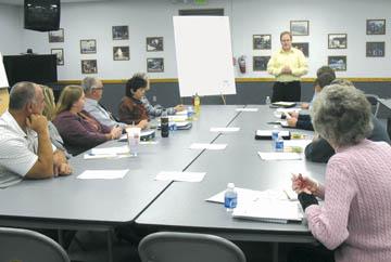 John Marron, Program Manager at the Indiana Association for Community Economic Development addresses a group of Waynedale residents on November 15, 2010.