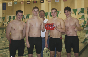 Bishop Luers swimmers (L-R) Mark Hellinger, Daniel Colvin, Coach Jeff Siples, Alex Miller and Henry Till.