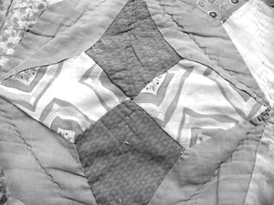 """Job's tears block undergoing restoration. The pieces with the big squares are cut from a Sears–Charmode  Jamarettes  """"man-tailored"""" pajama top."""