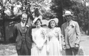 On June 3, 1940 at the corner of Webster and Masterson, Dorothea poses for a photo the day of her wedding. The aqua-colored wedding dress cost $3.95. Her best friend since third grade, Velva Openlander was Dorothea's maid of honor. (L-R) Frederick Lebrecht, Dorothea (Koonce) Lebrecht, Velva Openlander and Frank Lebrecht.