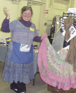 Suzanne Pufpaff models her knitted garments.