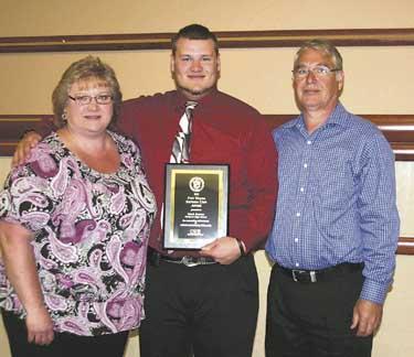 Elmhurst High School's Mark Sexton, along with his parents Roberta and James Sexton.