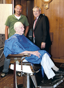 Walking through Waynedale Mayor Henry visits Meyer's Barber Shop on Lower Huntington Road.