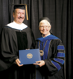 LOCAL BUSINESS LEADER RECEIVES HONORARY USF DOCTORATE