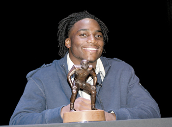 """Jaylon Smith proudly holds his Butkus Award in which the inscription reads, """"When a player receives the Butkus Award he will know two things. First, he is recognized as the best of the best linebackers in America. Second, and in the long run most important, he will understand that this recognition brings a responsibility to serve others by giving back.-Dick Butkus."""""""