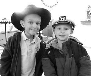 Brothers Edward and Charles Stronczek have fun wearing their hats on the day students brought in $1 for the privilege of wearing a hat at school.