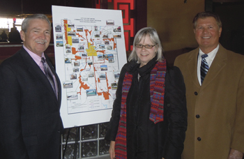 Mayor Tom Henry and Fifth District Councilman Geoff Paddock congratulate Lois Eubank, Born Again Quilts on her commercial façade grant award.