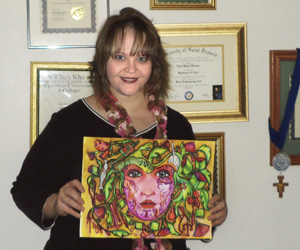 "Nena Brown and her award winning entry ""Tapestry of Women"""