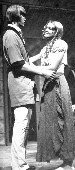 """Melissa (Hunter) Long captivates audience in a play called """"My Three Angels."""" Melissa was part of a ten-member cast directed by Donald Goss. In this photo Paul (Geoff Sills) and Marie Louise (Melissa Hunter) meet. Photo taken from Elmhurst High School 1975 Yearbook."""