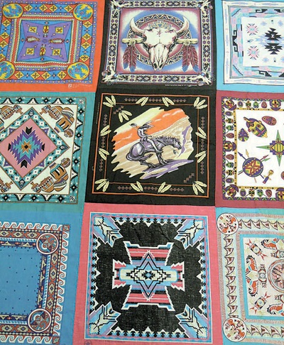 Joan's bandana quilt top is in need of machine quilting so she can give it to her grandson before dying.