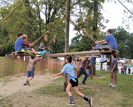 An old-time wood and rope merry-go-round, built and staffed by a local Boy Scout troop, is a perennial favorite in the Younguns' Fun area of the Forks of the Wabash Pioneer Festival in Huntington.