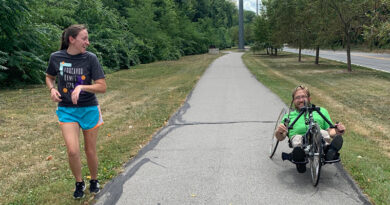 ENCOURAGING THE COMMUNITY TO MOVE 100 MILES TO CREATE SMILES